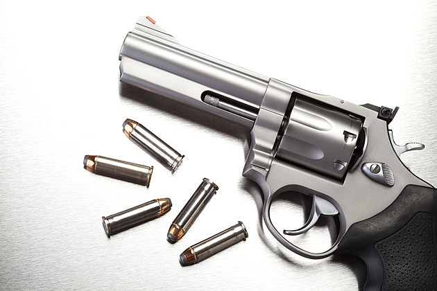 gun with bullets on steel